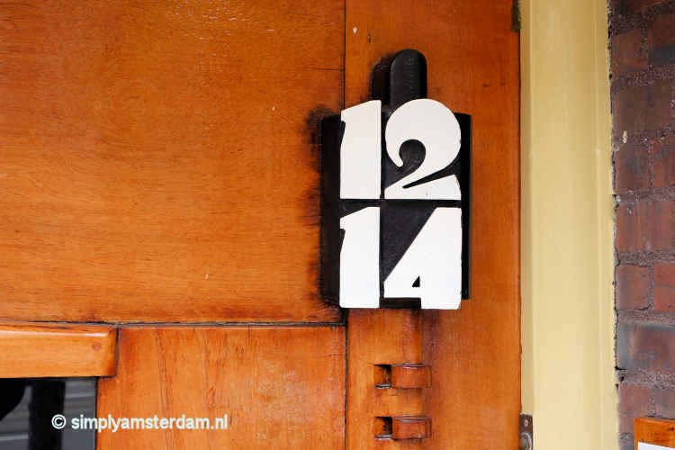 Typical Amsterdamse School design house numbers