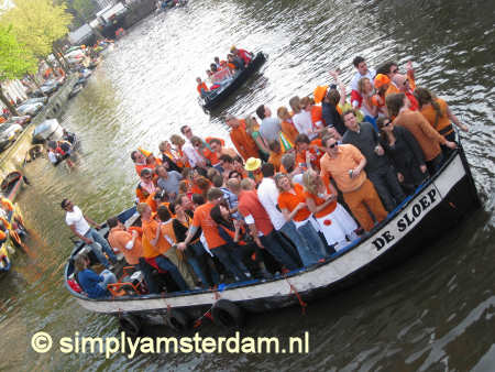 Queensday boat in canal